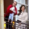 Prince William & Kate Middleton hold baby over balcony